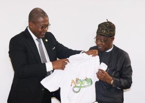 PIC. 1: The Director General of the Nigerian Tourism Development Corporation (NTDC), Mr. Folorunsho Coker (left), presenting a souvenir to the Minister of Information and Culture, Alhaji Lai Mohammed (right), when the Minister paid a working visit to the NTDC headquarters in Abuja on Tuesday